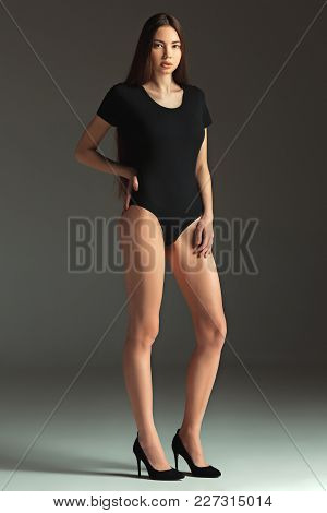 I Am Young And Pretty. Fashion Caucasian Woman. Portrait Of Beautiful Teen Model In A Black Swimsuit