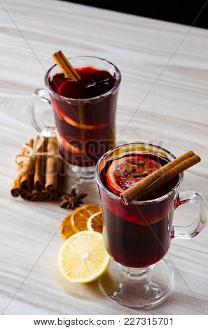 Mulled wine glintwine served in glasses for christmas table