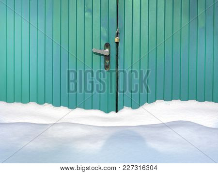 Massive Snow In Front Of The Metal Fence With Entrance Locked, Outdoor Front Shot