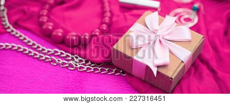 Banner Gifts Packed In Kraft Boxes Tied With Satin Ribbon.