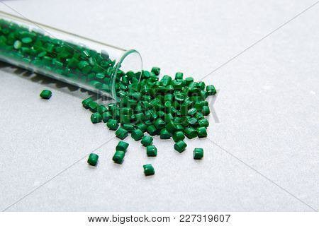 Plastic Pallets . Plastic Raw Materials In Granules For Industry.green Polymeric Dye On A Silver Bac