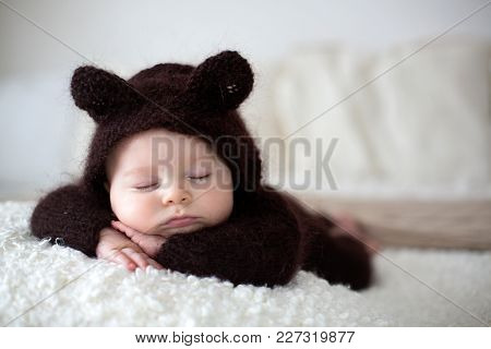 Sweet Little Baby Boy, Dressed In Handmade Knitted Brown Soft Teddy Bear Overall, Sleeping Cozy At H