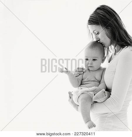 Mother, Holding Her Sick Baby Boy, Sad Baby, Isolated On White Background