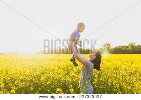 Joyful Woman Walk On Green Yellow Flowering Field Background, Rest, Have Fun, Play, Toss Up Little C
