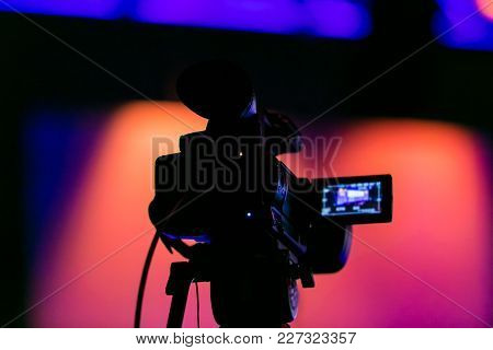 Silhouette Of A Tv Camera For Breaking News