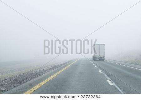 Semi-truck Drives Into Dense Fog