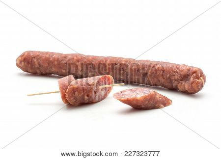 One Hungarian Dry Sausage Pepperoni And Two Pieces Isolated On White Background Smoked In Natural Ca