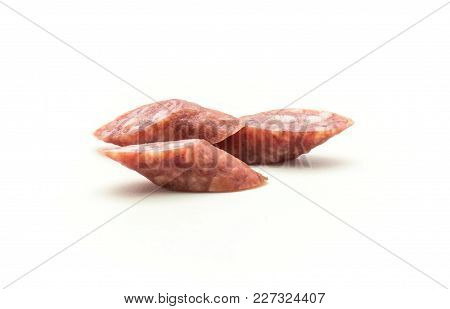 Three Hungarian Dry Sausages Pepperoni Cut Pieces Isolated On White Background Smoked In Natural Cas
