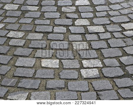 Texture Of Old Cobblestone Pavement As Background