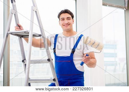 Painter repairman working at construction site