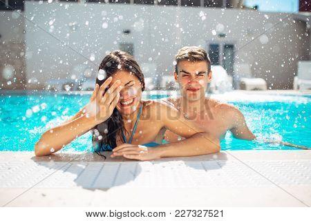 Screaming Young Teenage Girl At The Pool Annoyed With Pool Splashing.splashing Water And Playing Gam