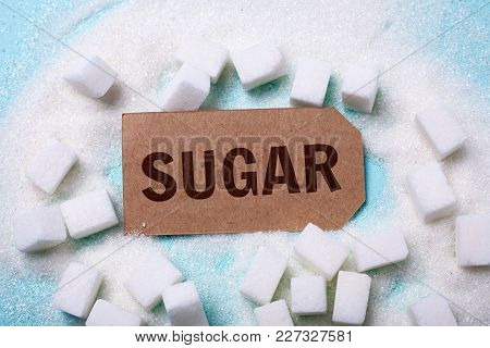 Sugar Word On A Green Background With A Bunch Of Sugar