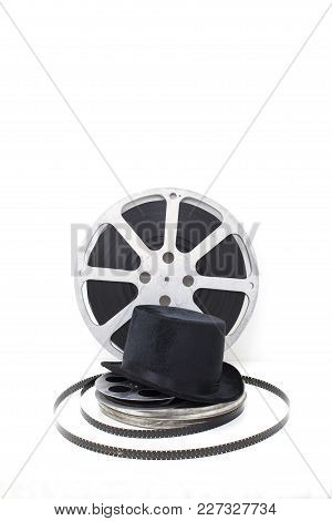 Film Reels Of Old Movies And Black Hat On White Background.concept Cinema