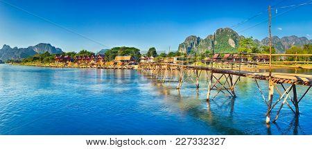 Beautiful view of a bamboo bridge.Vang Vieng. Laos landscape. Panorama