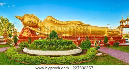 Reclning Buddha at  Pha That temple. Vientiane, Laos. Panorama
