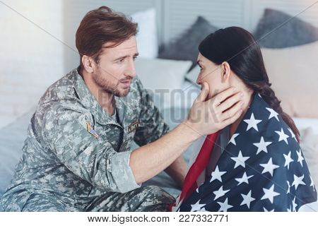 Do Not Worry My Love. Millennial Military Servant Embracing His Wife While Saying Her Parting Words