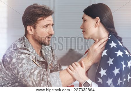 Remember That I Love You. Side View On A Loving Couple Saying Goodbye Before Emollient Military Husb