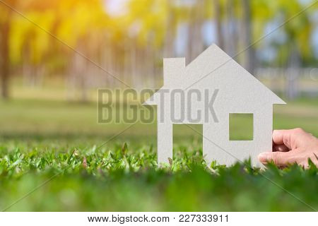Paper Cut Of House On Nature Background With Copy Space