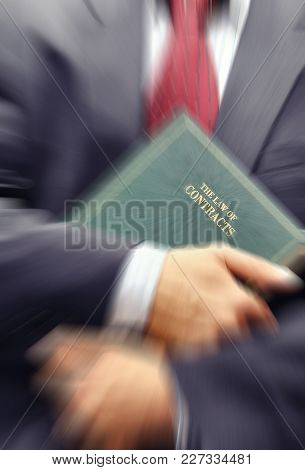Lawyer Holding A Book, Law And Justice Concept.