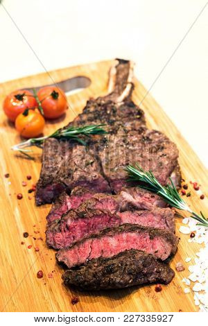 Rosted and grilled Beef Rib Steak, american groumet cuisine.