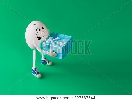 Funny Miniature Easter Egg Boy Holding Present Box Against Colorful Background.
