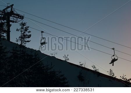 Cable Car On Sky Resort Against Evening Sky, Silhouette Shot, Wide Angle