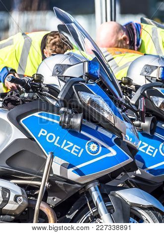 Close-up Of German Police Motor Bikes With Anonymous Police Men In The Background