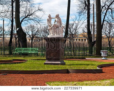 Sculptures Of Nymph And Satire On A Pedestal In The Summer Garden Before The Opening Of The Summer S