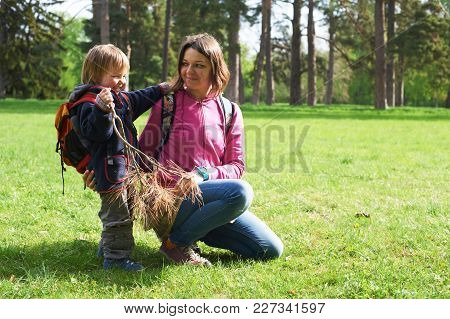 Beautiful Mother And Her Cute Son Walking In The Park