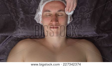 Close-up Of A Face Cleansing. Man In Spa Salon On Procedure