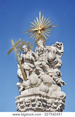 The Main Statue On A Pedestal Outside The St. Matthias Church On Castle Hill In Budapest Features Tw