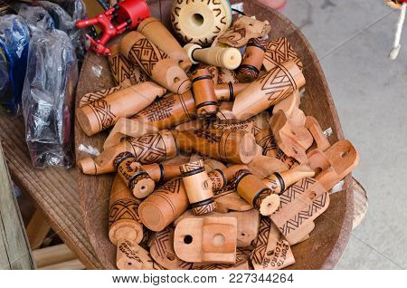 Handmade Wooden Whistles That Mimic Sounds Of Birds Sold At Handicraft Fairs In Brazil.