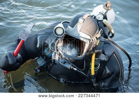 Commercial  Diver With Scuba Gear Working In The Water, Occupation In The Offshore Industry