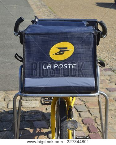 Le Mans, France - August 31, 2017: Yellow Bicycle Of A Post Office La Poste Of French City Parked On