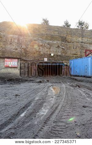 Entrance To A Subterranean Fiery Cola Mine