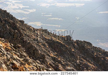 Silhouettes Of Tourists On The Krywan Ridge. High Tatra Mountains. Slovakia.