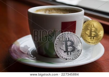 Two Bitcoins One Silver Second Gold On The Porcelain Cup Of Coffee|future|payment|beverage