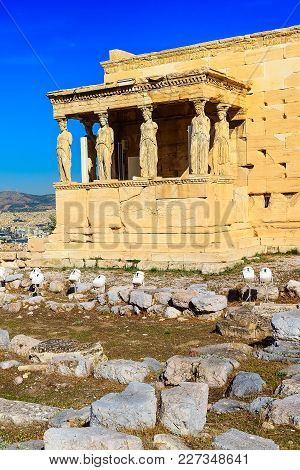 Acropolis, Porch Of Caryatids, Erechtheum Temple In Athens, Greece And Blue Sky