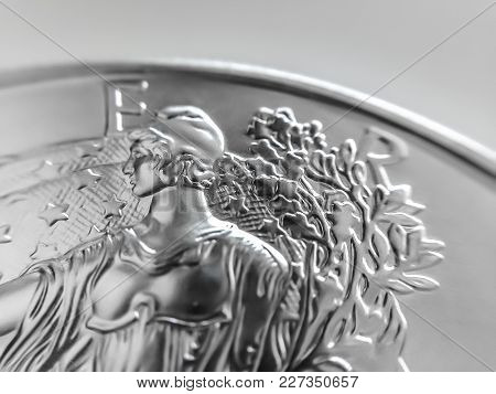 Macro Close Up Of A Silver Coin