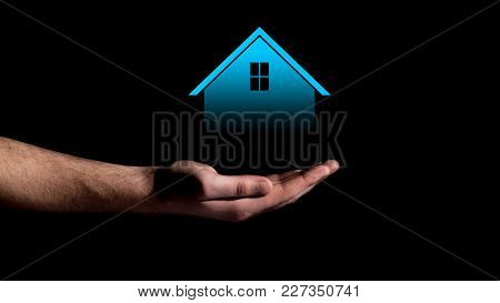 Hand Showing On Mortgage Concept Projection Of House