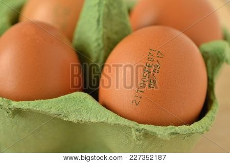Close Up Of Eggs In Package With Expiration Date