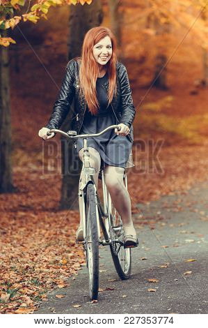 Woodland Nature Outdoor Relax Leisure Concept. Redhead Lady Cycling In Park. Ginger Girl Riding On B