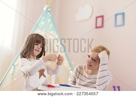 Mother And Daughter Playing In A Play Room, Cutting Paper, Making Decorations