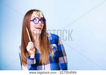 Woman Confused Thinking Seeks A Solution, Paper Card With Light Idea Bulb On Her Head. Excited Girl