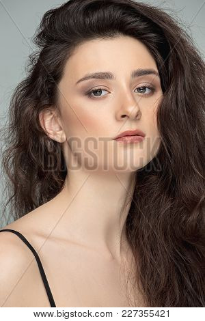 I Am Pretty. The Beautiful Female Face. Beauty Portrait Of A Charming Woman Looking At Camera At Stu