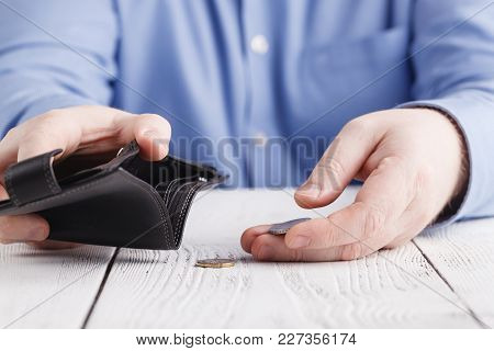Empty Wallet In Man Hands In Hands
