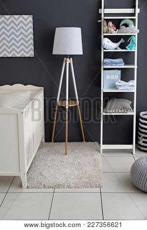 Children's room interior with crib and shelving unit