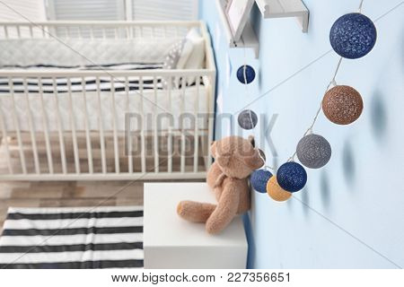 Beautiful garland on wall in children room