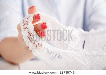 Sexy Transparent Panties On White Background In Female Hands