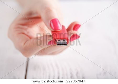Close Up View Of Usb Flash Pendrive In Female Hand